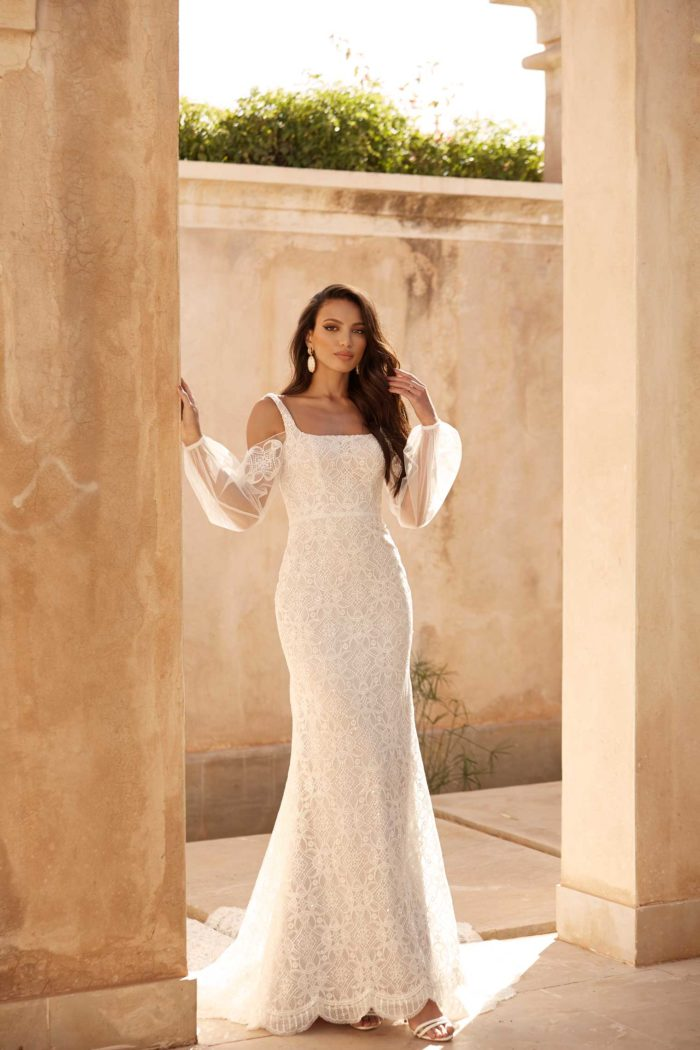 ADELAIDE-ML15010-FULL-LENGTH-FITTED-GOWN-WITH-LOW-BACK-AND-DETACHABLE-OVERSKIRT-SLEEVES-AND-BELT-WEDDING-DRESS-MADI-LANE-BRIDAL1